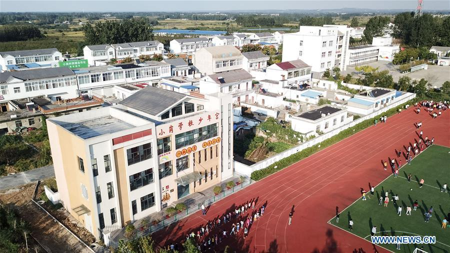 Aerial photo taken on Sept. 26, 2018 shows Xiaogang Primary School in Xiaogang Village of Fengyang County, east China\'s Anhui Province. Xiaogang, known as cradle of China\'s rural reform, witnessed great change in the past 40 years. (Xinhua/Zhang Duan)