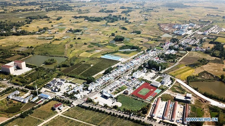 Aerial photo taken on Sept. 27, 2018 shows the view of Xiaogang Village in Fengyang County, east China\'s Anhui Province. Xiaogang, known as cradle of China\'s rural reform, witnessed great change in the past 40 years. (Xinhua/Zhang Duan)