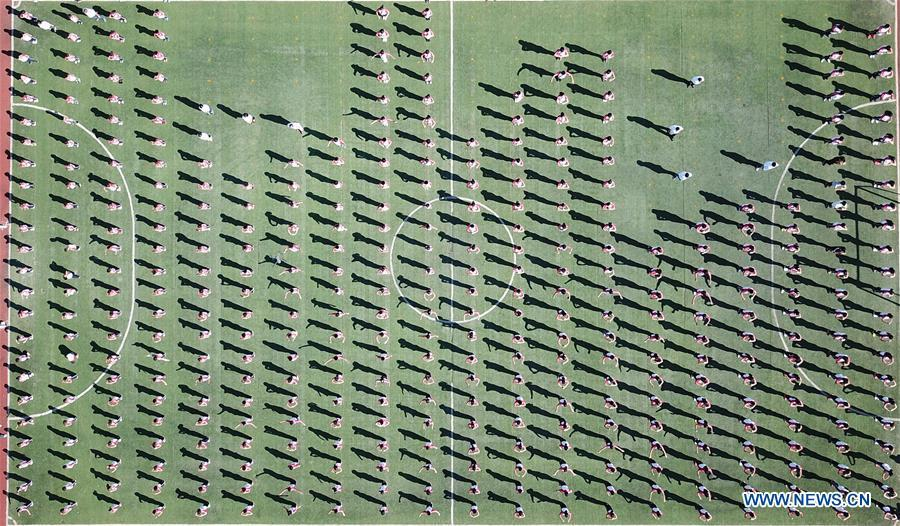 Aerial photo taken on Sept. 27, 2018 shows students doing exercise at Xiaogang Primary School in Xiaogang Village of Fengyang County, east China\'s Anhui Province. Xiaogang, known as cradle of China\'s rural reform, witnessed great change in the past 40 years. (Xinhua/Cai Yang)