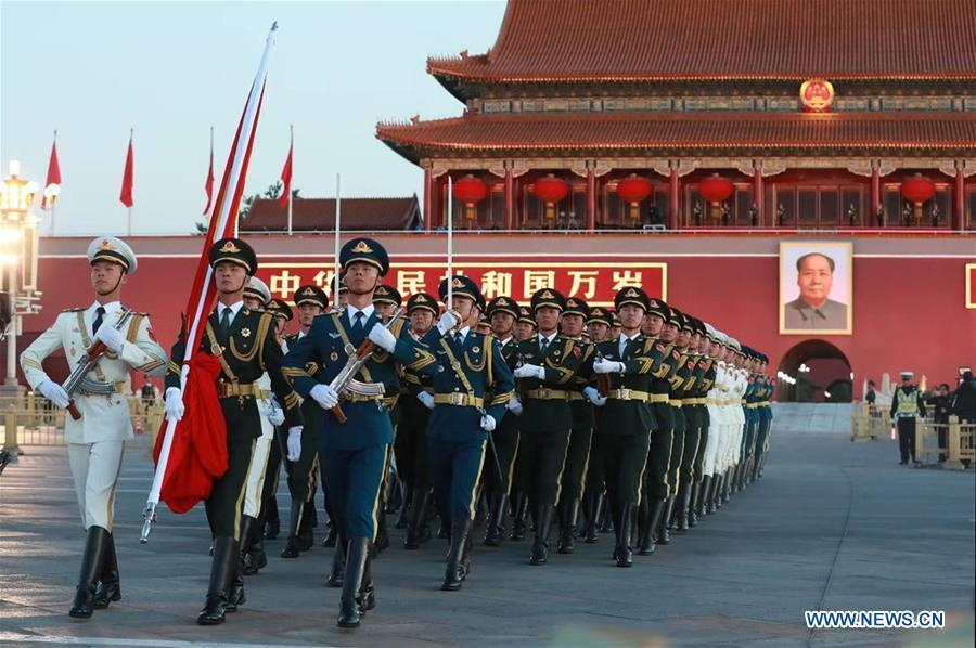The guard of honor escorts the national flag for a national flag-raising ceremony in a celebration of the National Day at the Tian\'anmen Square in central Beijing, capital of China, on Oct. 1, 2018, the 69th anniversary of the founding of the People\'s Republic of China. (Xinhua/Ju Zhenhua)