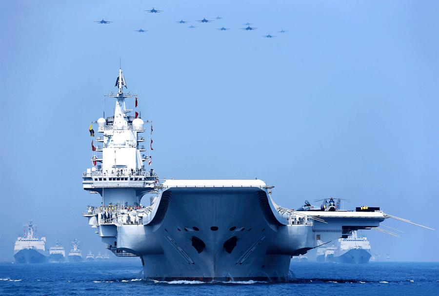 Liaoning, China\'s first aircraft carrier, parades in formation on the South China Sea on April 12, 2018. [ZHANG LEI/FOR CHINA DAILY]