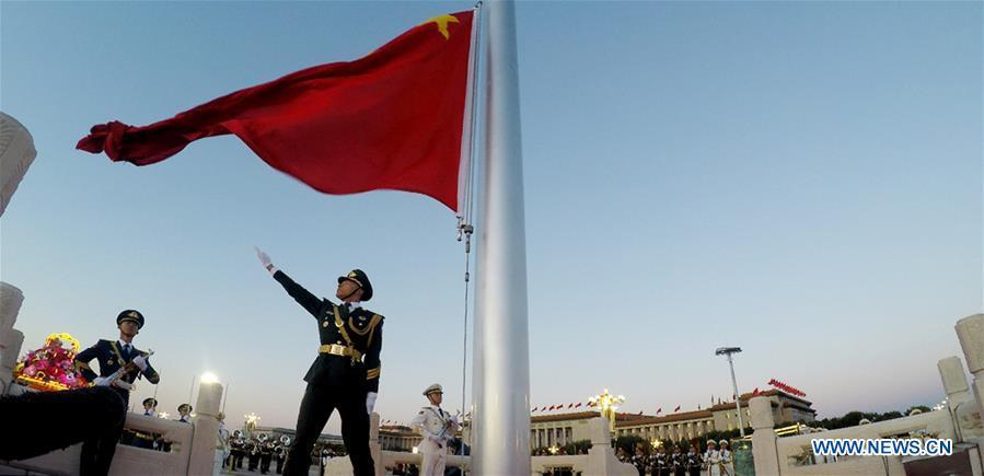 A national flag-raising ceremony is held to celebrate the National Day at the Tian\'anmen Square in central Beijing, capital of China, on Oct. 1, 2018, the 69th anniversary of the founding of the People\'s Republic of China. (Xinhua/Ju Zhenhua)