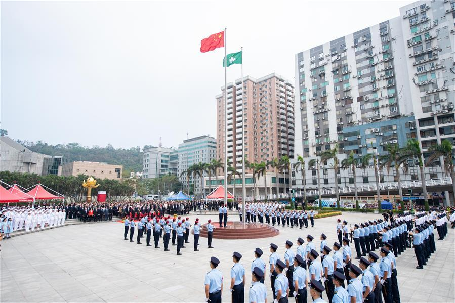 A national flag raising ceremony is held at the Golden Lotus Square in Macao, south China, on Oct. 1, 2018, the National Day, to celebrate the 69th anniversary of the founding of the People\'s Republic of China. (Xinhua/Cheong Kam Ka)