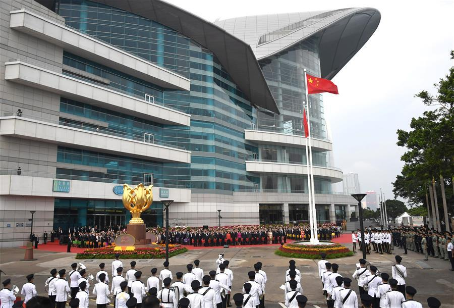 A national flag raising ceremony is held at the Golden Bauhinia Square in Hong Kong, south China, on Oct. 1, 2018, the National Day, to celebrate the 69th anniversary of the founding of the People\'s Republic of China. (Xinhua/Lui Siu Wai)