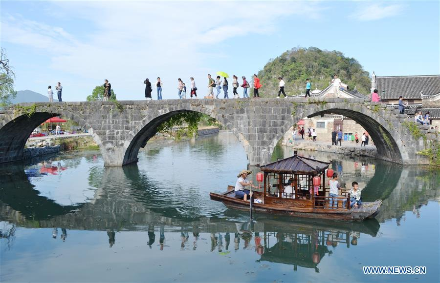 <?php echo strip_tags(addslashes(Tourists visit Shanggantang Village in Jiangyong County, central China's Hunan Province, Oct. 3, 2018, the third day of the week-long National Day holiday. (Xinhua/Tian Rurui))) ?>