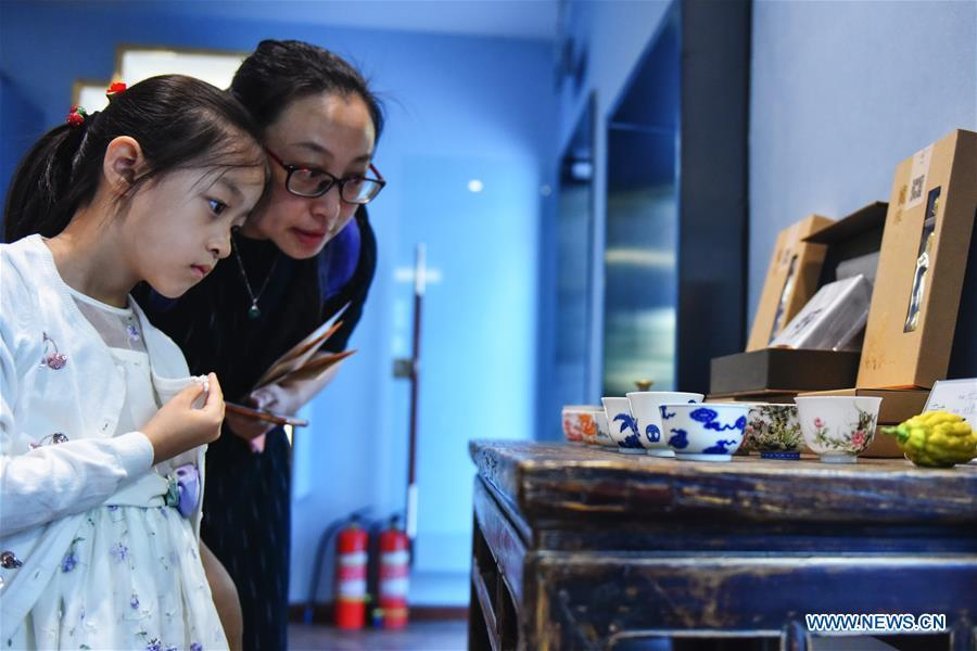 Visitors view the tea set displayed at the Beijing Design Week in Beijing, capital of China, Oct. 4, 2018. The Beijing Design Week, a platform aimed at promoting the concept of a sustainable development of creative and design industry, last from Sept. 22 to Oct. 7. (Xinhua/Li Mangmang)