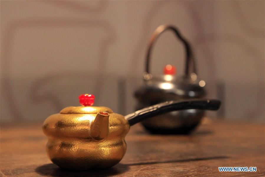 Photo taken on Oct. 4, 2018 shows the tea pots displayed at the Beijing Design Week in Beijing, capital of China. The Beijing Design Week, a platform aimed at promoting the concept of a sustainable development of creative and design industry, last from Sept. 22 to Oct. 7. (Xinhua/Sui Xiankai)