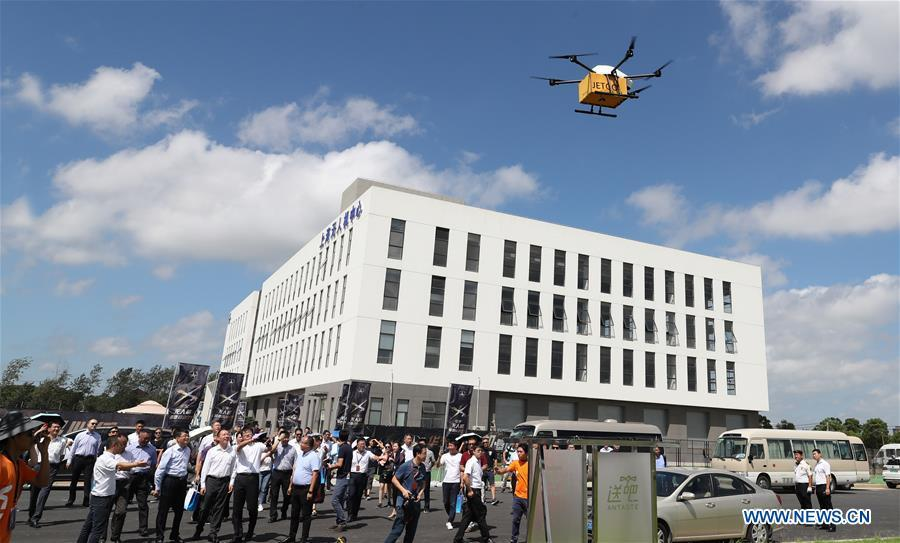 A drone carrying takeout flies above East China Unmanned Aerial Vehicles (UAV) Base in Shanghai, east China, Aug. 30, 2018. The UAV Base with airspace of 58 square kilometers for test-fly opened here on Aug. 30. The establishment of the base aims to boost the development of drone industry in Shanghai and East China. (Xinhua/Fang Zhe)