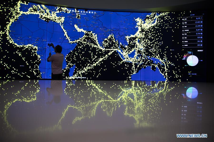Photo taken on Aug. 12, 2018 shows a screen displaying real-time coordinates of global vessels in Shanghai, east China. Connecting 22 government departments, China (Shanghai) International Trade Single Window provides services covering one third of the total volume of China\'s import and export trade. At present, more than 270,000 enterprises have enjoyed the single-window services which enable them to complete administrative procedures for foreign trade. (Xinhua/Jin Liwang)