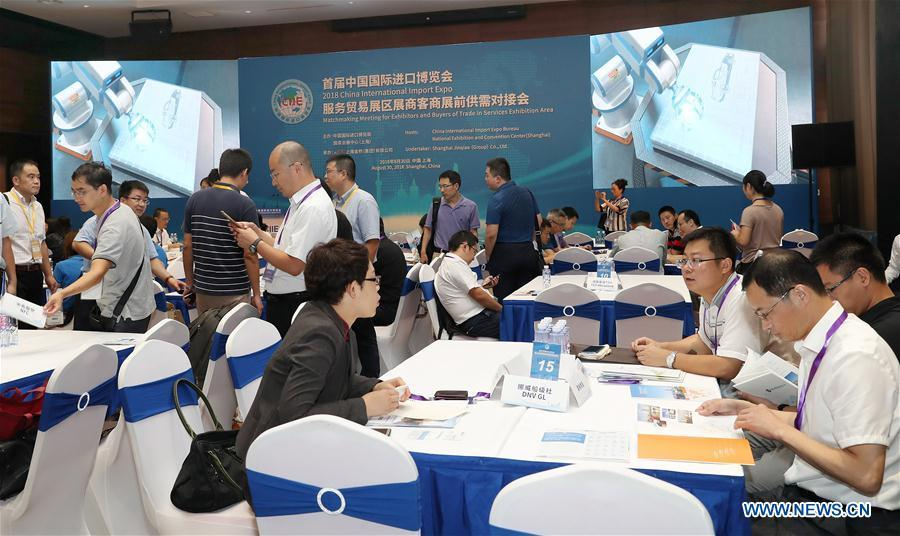 Enterprise representatives attend the Matchmaking Meeting for Exhibitors and Buyers of Trade in Services Exhibition Area of the 2018 China International Import Expo in Shanghai, east China, Aug. 30, 2018. (Xinhua/Fang Zhe)