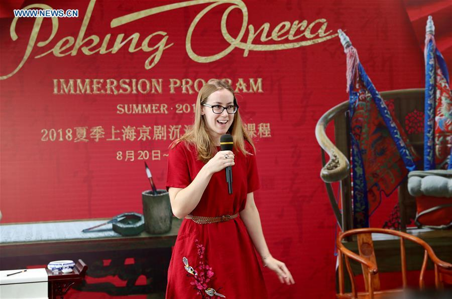 A student from Princeton University makes self-introduction at the opening ceremony of an immersion program for international students to learn about Peking Opera and Chinese aesthetics in Shanghai, east China, Aug. 20, 2018. (Xinhua/Liu Ying)