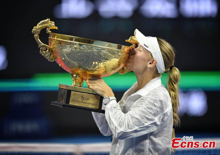 Caroline Wozniacki of Denmark celebrates with the trophy after winning the match against Anastasija Sevastova of Latvia at the final of women's singles during the China Open in National Tennis Center, Beijing, China, October 7, 2018. (Photo: China News Service/Li Peirun)
