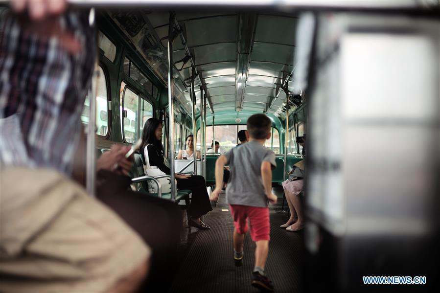 People visit a vintage bus during the 25th Annual Bus Festival in New York, the United States, on Oct. 7, 2018. The New York Transit Museum held its 25th annual bus festival on Sunday. The buses on display represent about 80 years of surface transit history in New York City. The oldest bus at the festival, Bus 1263, is a double-decker bus that was purchased by the Fifth Avenue Bus Company in 1930. (Xinhua/Li Muzi)