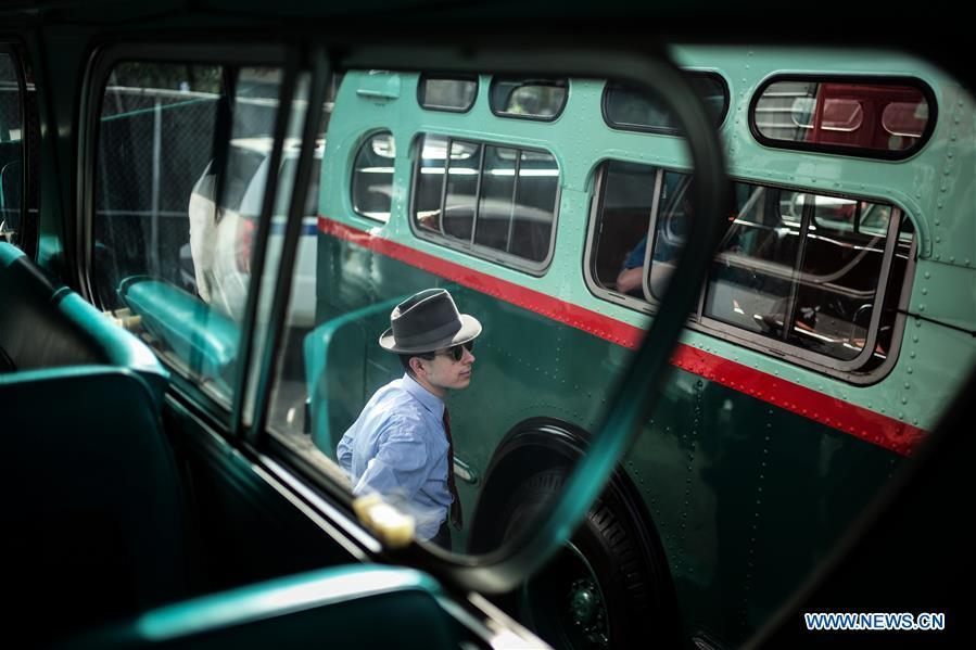 A man takes photos of a vintage bus during the 25th Annual Bus Festival in New York, the United States, on Oct. 7, 2018. The New York Transit Museum held its 25th annual bus festival on Sunday. The buses on display represent about 80 years of surface transit history in New York City. The oldest bus at the festival, Bus 1263, is a double-decker bus that was purchased by the Fifth Avenue Bus Company in 1930. (Xinhua/Li Muzi)