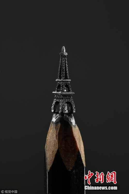 A artwork carved from the tip of pencil lead, by  Turkish artist Nihat Ozcan. Ozcan is one of the rare pencil carving artists in the world. He carves figures in miniature on the tips of pencils. (Photo/CFP)