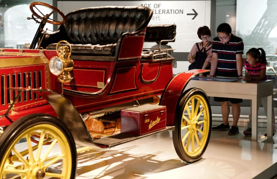 A girl, accompanied by her parents, visits Shanghai Auto Museum in Shanghai on Oct. 7, 2018. (Photo/Xinhua)