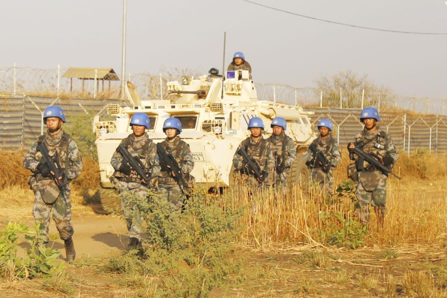 Chinese peacekeepers patrol in Juba, capital of South Sudan, to protect the population during the May Day holiday. (Photo/Xinhua)