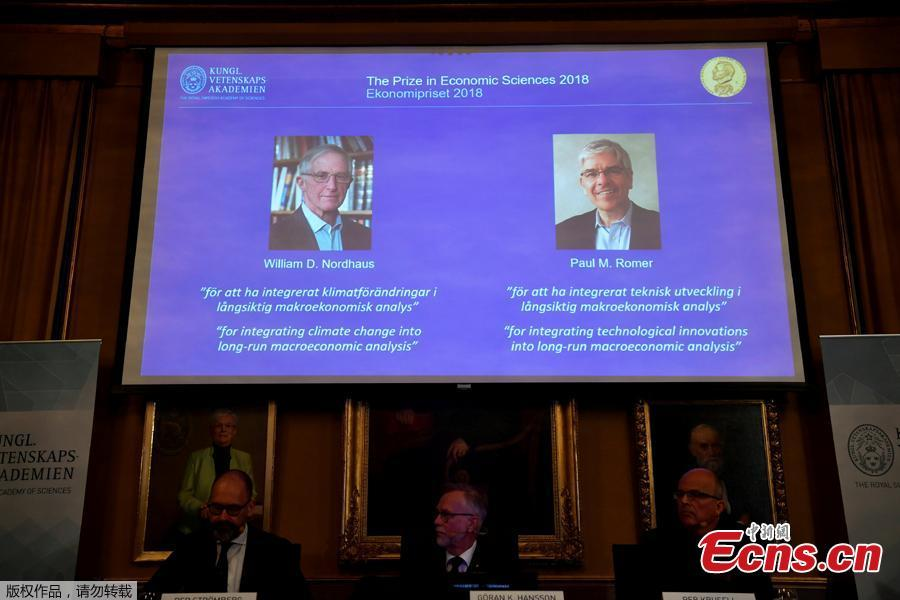 A screen displays the portraits of awarded economists William Nordhaus (L) and Paul Romer of the United States, in Stockholm, Sweden, Oct. 8, 2018. The 2018 Nobel Prize in Economics was awarded Monday jointly to William Nordhaus and Paul Romer. (Photo/Agencies)