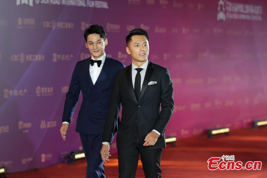 Actors walk on the red carpet at the 5th Silk Road International Film Festival in Xi'an City, Northwest China's Shaanxi Province, Oct. 8, 2018. (Photo: China News Service/Zhang Yuan)