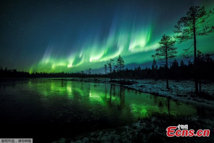 The Aurora Borealis (Northern Lights) is seen over the sky near Rovaniemi in Lapland, Finland, October 7, 2018. The Northern Lights moved in the sky with bright green arches reflected in frozen lake. (Photo/Agencies)