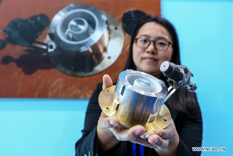 A staff member shows an electric thruster used on satellites during a press preview of the 2018 National Mass Innovation and Entrepreneurship Week in Beijing, capital of China, Oct. 8, 2018. The weekly event will run from October 9 to 15. (Xinhua/Zhang Yuwei)
