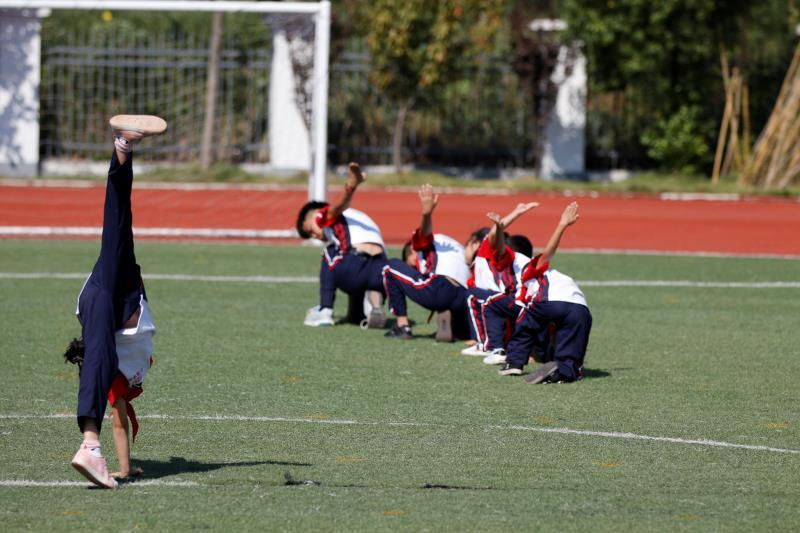 Xiaogang School students in a part-time martial arts class do exercises on Sept. 27. (Photo/chinadaily.com.cn)