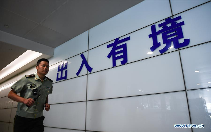 Wang Zhiguo is seen at an inspection station of Nanjing Lukou International Airport in Nanjing, capital of east China\'s Jiangsu Province, Aug. 7, 2018. Wang Jicai, who used to be head of the militia post on Kaishan Island in Jiangsu Province, started working on the island in the Yellow Sea with his wife in 1986. He died of sudden illness while on duty in July of 2018 at the age of 58. Wang Zhiguo, son of Wang Jicai, became a frontier defence policeman after his graduation from Nanjing University of Aeronautics and Astronautics in 2013. He had been assigned to many security tasks for major events during 5 years\' working. (Xinhua/Li Xiang)