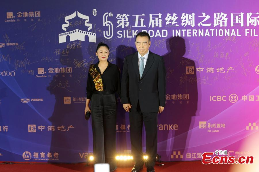 Chinese film director Chen Kaige and wife Chen Hong walk on the red carpet at the 5th Silk Road International Film Festival in Xi'an City, Northwest China's Shaanxi Province, Oct. 8, 2018. (Photo: China News Service/Zhang Yuan)