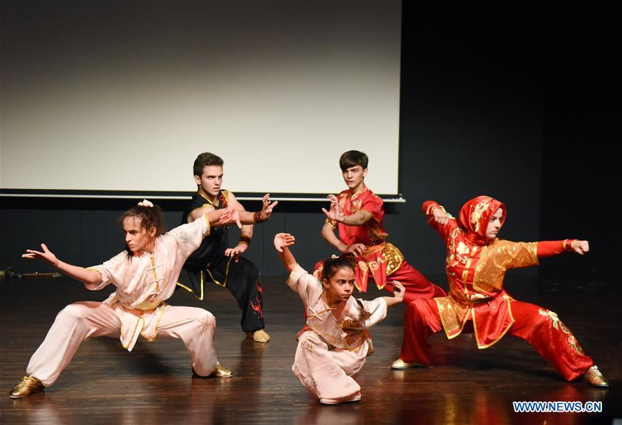 Members of the Turkish Kung Fu national team perform in Bogazici University of Istanbul, Turkey, on Oct. 9, 2018. A charm of Chinese Kung Fu tour started on Tuesday evening at Bogazici University in Istanbul, enchanting the audience with a mixture of Chinese martial arts and dances. (Xinhua/He Canling)