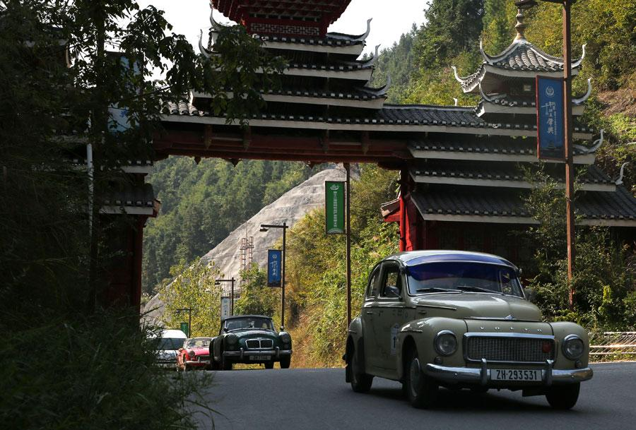 A group of 16 vintage cars arrived at a Dong ethnic village in Liping, Southwest China\'s Guizhou province on Oct. 8, 2018, after traveling through seven countries. (Photo provided to chinadaily.com.cn)
