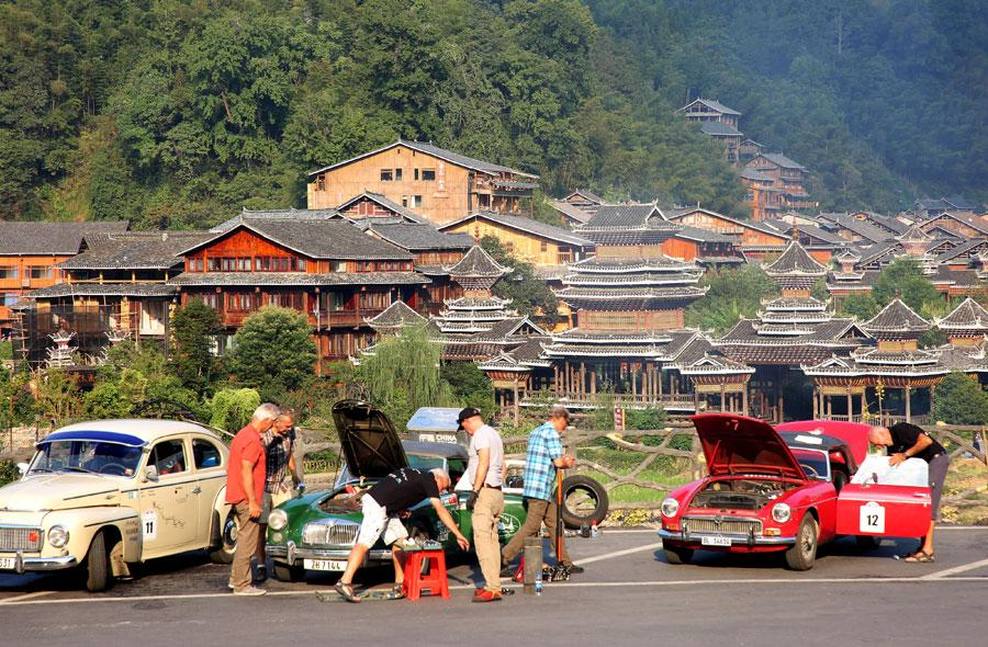 Drivers check the condition of their cars at a parking area, Oct 8, 2018. The drivers, the eldest aged 84, departed Germany on Aug. 19. (Photo provided to chinadaily.com.cn)