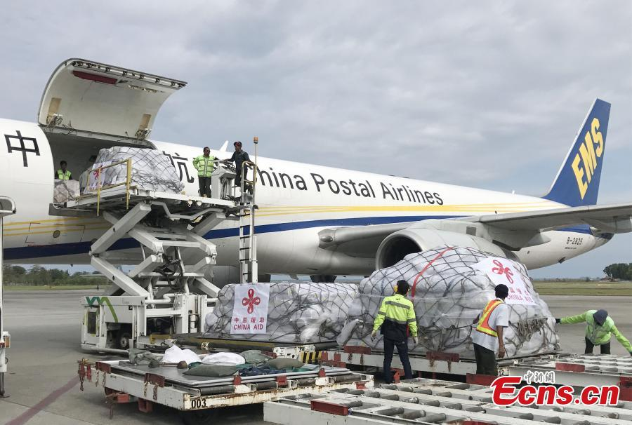 The first batch of humanitarian supplies from the Chinese government for Indonesia\'s quake victims arrives at Balikpapan International Airport in eastern Kalimantan Island, Indonesia, on Oct. 9, 2018. The aid, consisting of tents, water treatment equipment, generators and other supplies, will be delivered to the earthquake and tsunami-hit areas in Central Sulawesi province soon. There are still four batches of this kind of aid to be delivered in days. (Photo provided to China News Service)