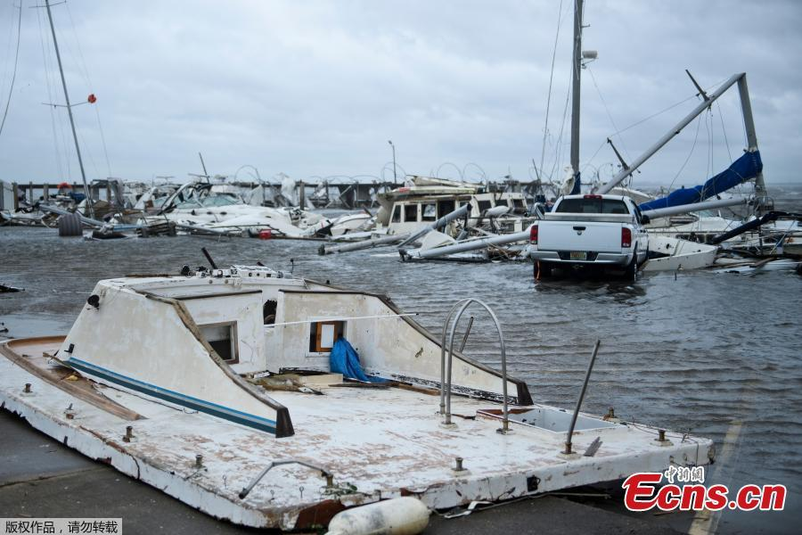 Damaged boats and a truck are seen in a marina after Hurricane Michael October 10, 2018 in Panama City, Florida. Michael slammed into the Florida coast on October 10 as the most powerful storm to hit the southern US state in more than a century as officials warned it could wreak \