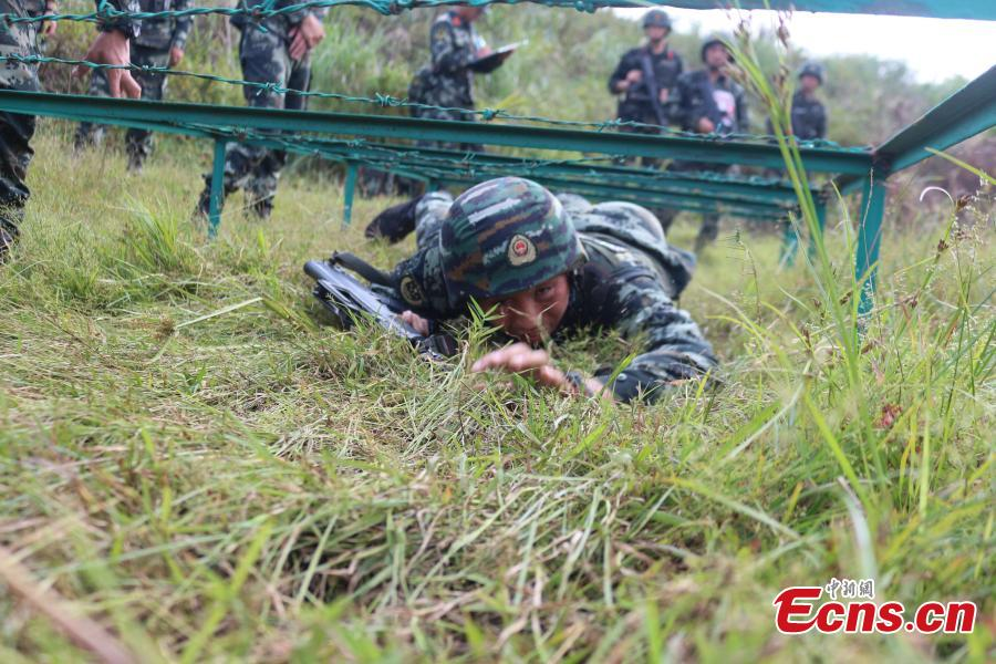 Some 200 Chinese armed police officers receive training in Fangchenggang City, South China's Guangxi Zhuang Autonomous Region. The week-long training includes demanding search and rescue operations in mountain and forest settings, and rapid response to infection outbreak scenarios. (Photo: China News Service/Cui Cheng)