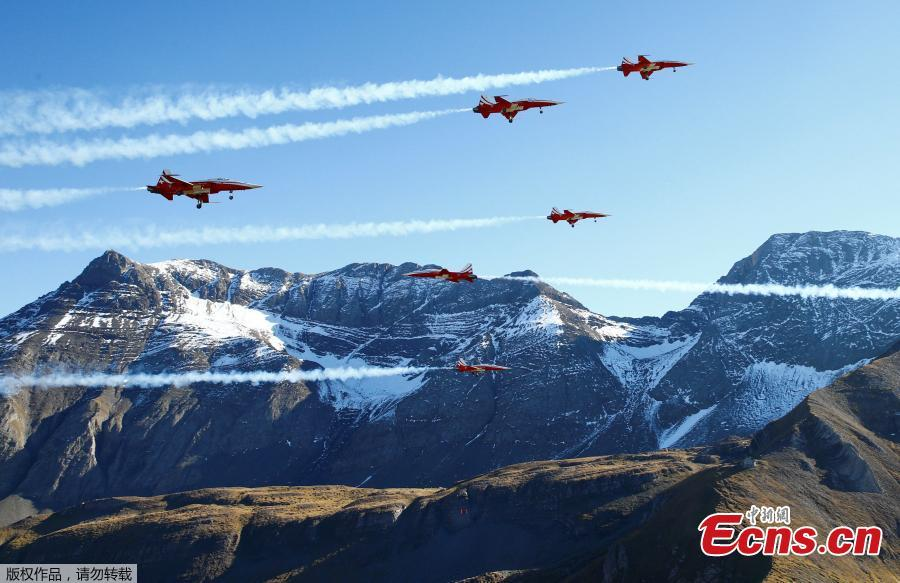 Members of the Patrouille Suisse perform the so-called \