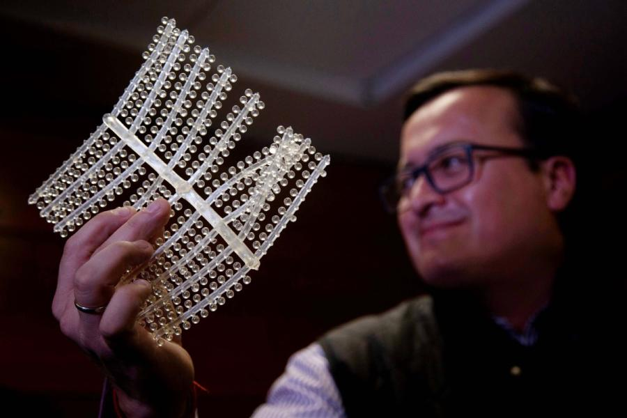 Engineer Christian Olivares shows a sheet of PVA, which could help prevent ecological damage in the world\'s oceans. (CLAUDIO REYES/FOR CHINA DAILY)