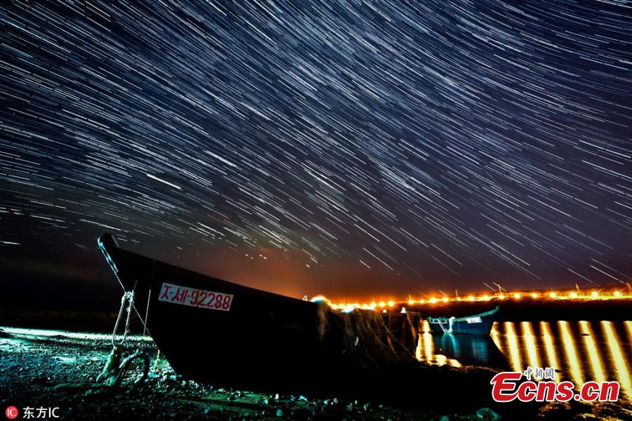 Photo taken on Oct. 10, 2018 shows the Draconids meteor shower in Russia's Far East region. (Photo/IC)