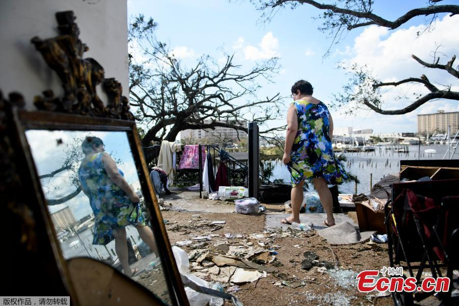 Teresa Sheffield walks out of the remains of her second floor apartment in the aftermath of Hurricane Michael October 11, 2018 in Panama City, Florida. (Photo/Agencies)