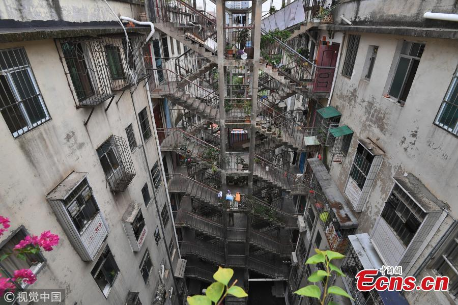 Two residential buildings share a stairwell in a community in Nanning City, South China's Guangxi Zhuang Autonomous Region, Oct. 11, 2018. (Photo/VCG)