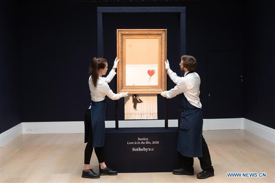 Sotheby\'s staff members present Banksy\'s \