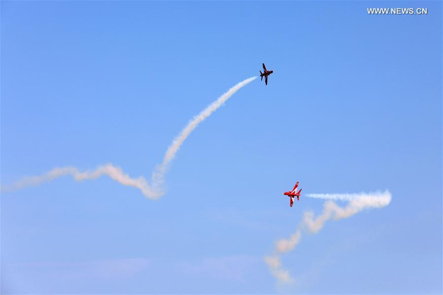 Photo taken on Oct. 13, 2018 shows model aircrafts with turbojet engines perform in the air during a contest in Rongcheng, east China\'s Shandong Province. A total of 12 teams from around the world compete in the air. (Xinhua/Lin Haizhen)