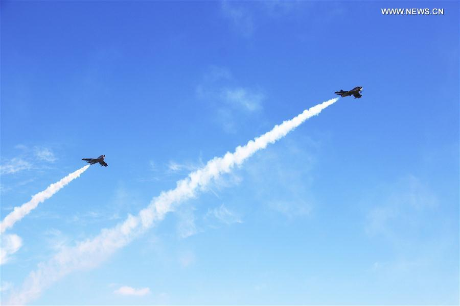 Photo taken on Oct. 13, 2018 shows model aircrafts with turbojet engines perform in the air during a contest in Rongcheng, east China\'s Shandong Province. A total of 12 teams from around the world compete in the air. (Xinhua/Zhang Binbin)