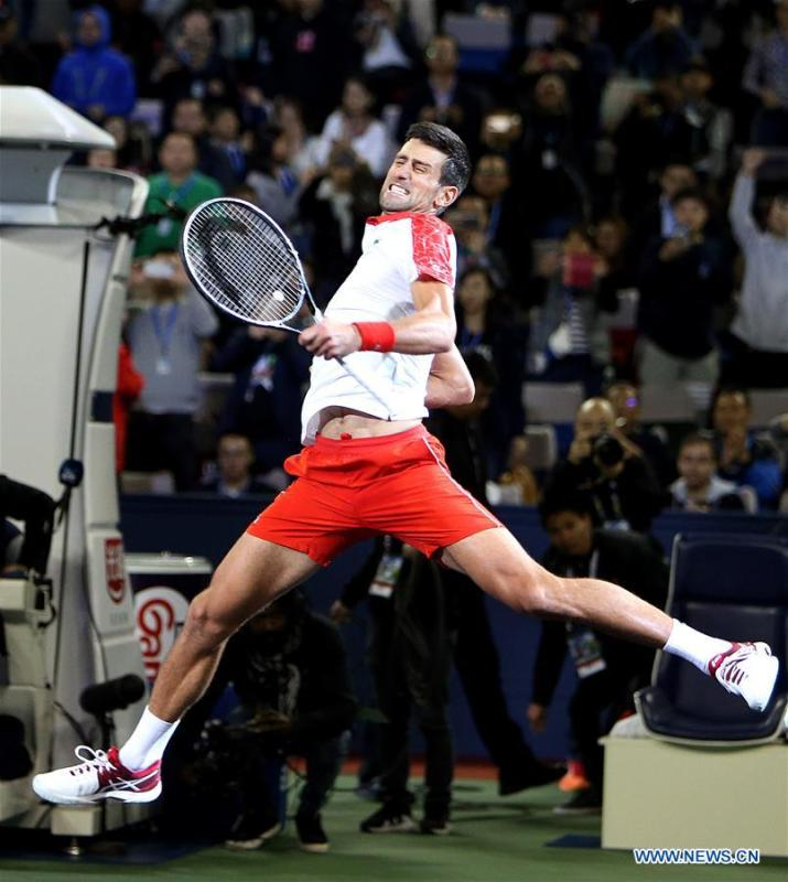Novak Djokovic of Serbia celebrates after winning the men\'s singles final match against Borna Coric of Croatia at 2018 ATP Shanghai Masters tennis tournament in Shanghai, east China, Oct. 14, 2018. Novak Djokovic won 2-0 in the final and claimed the title of the event. (Xinhua/Fan Jun)