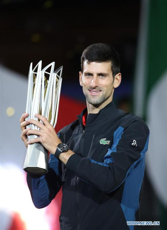 Novak Djokovic of Serbia poses with the trophy during the awarding ceremony of the men\'s singles event at 2018 ATP Shanghai Masters tennis tournament in Shanghai, east China, Oct. 14, 2018. Novak Djokovic won 2-0 in the final and claimed the title of the event. (Xinhua/Ding Ting)