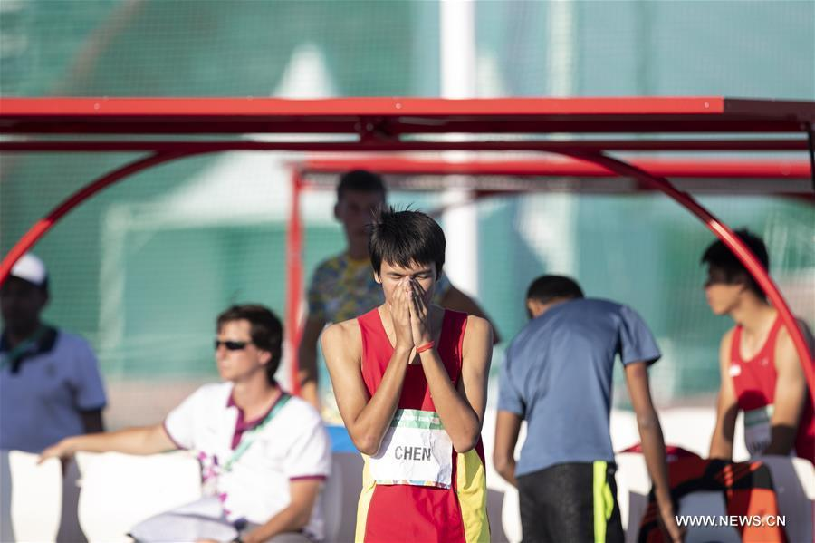 Chen Long of China reacts during the men\'s high jump of athletics event at the 2018 Summer Youth Olympic Games in Buenos Aires, Argentina, on October 14, 2018. Chen won the gold medal. (Xinhua/Li Ming)