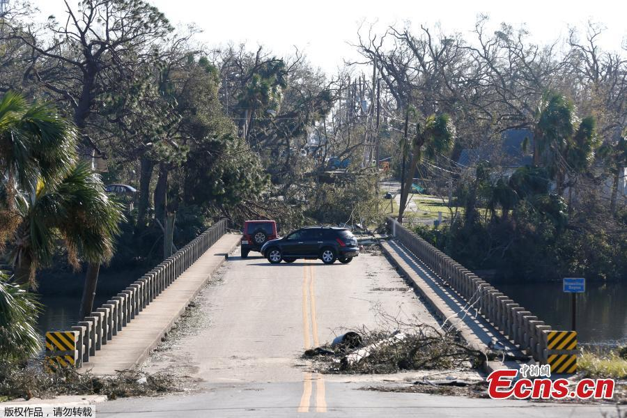 Drivers turn around on a bridge blocked by debris in the aftermath of Hurricane Michael in Panama City, Florida, U.S., October 13, 2018. Dozens of people remained missing on Sunday in Florida Panhandle communities reduced to ruins by Hurricane Michael as rescuers said they expected the death toll to rise and survivors grappled with power outages and shortages of food and water. (Photo/Agencies)