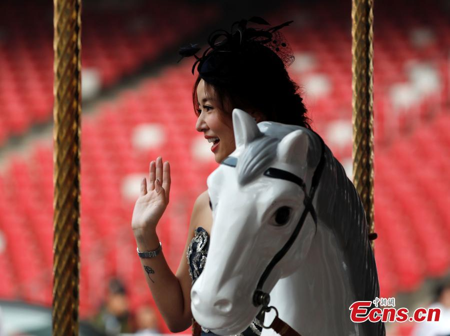 Ruby Lin Xinru, actress, poses for a photo in the 8th Longines Equestrian Beijing Masters at the National Stadium in Beijing, Oct. 14, 2018. One of the grandest international equestrian events in China, it was jointly organized by Chinese Equestrian Association and the National Stadium. A total of 251 pairs of horses and riders joined the competition from Oct. 12 to 14, with the total prize money of 2.33 million yuan. (Photo: China News Service/Liu Guanguan)