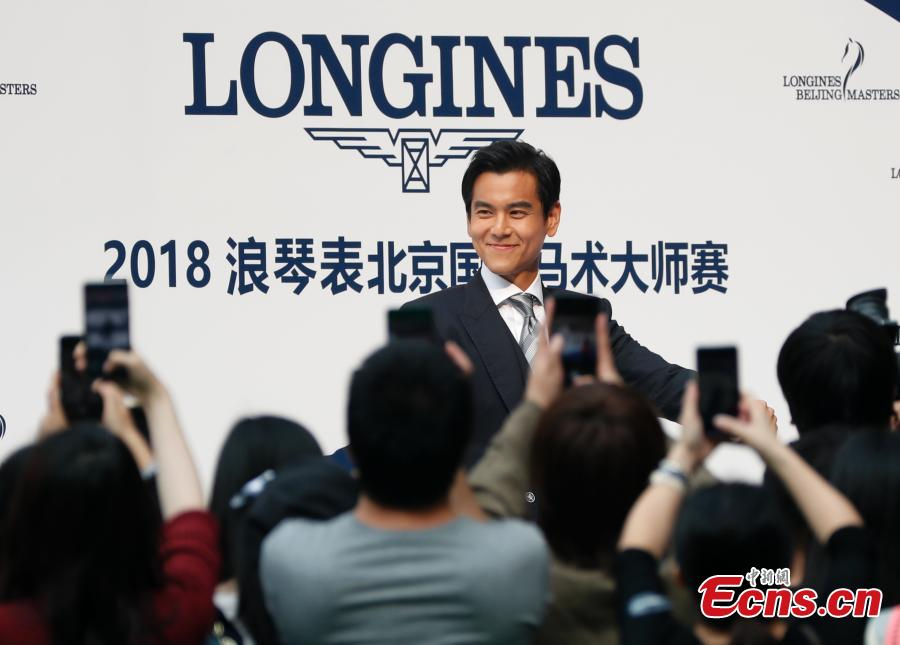 Eddie Peng Yu-yen, actor and singer, poses for a photo in the 8th Longines Equestrian Beijing Masters at the National Stadium in Beijing, Oct. 14, 2018. One of the grandest international equestrian events in China, it was jointly organized by Chinese Equestrian Association and the National Stadium. A total of 251 pairs of horses and riders joined the competition from Oct. 12 to 14, with the total prize money of 2.33 million yuan. (Photo: China News Service/Liu Guanguan)