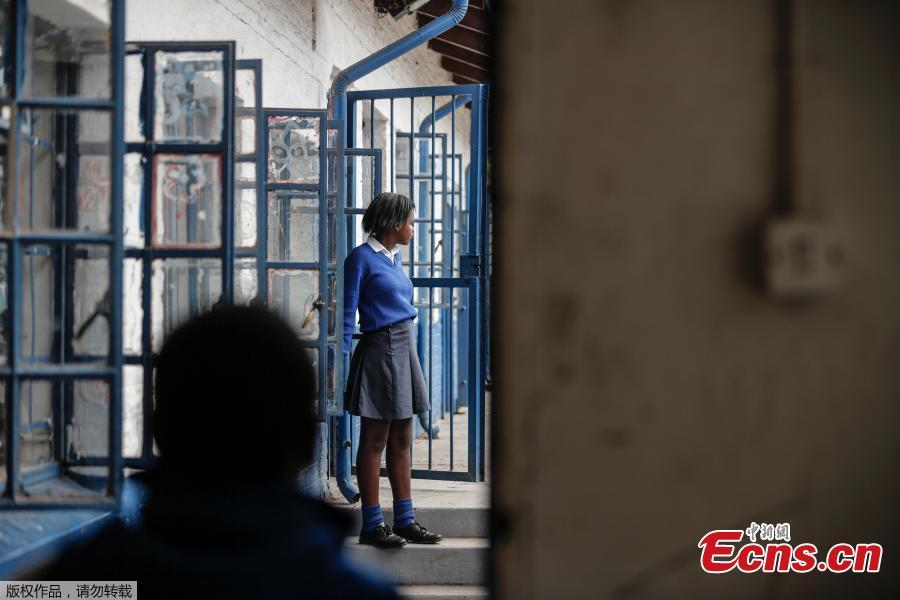 A girl dressed in school uniform is pictured in the corridor of Mbuyisa Makhubu Primary School in the area of Orlando West, in the South African township of Soweto, on October 10, 2018. (Photo/Agencies)