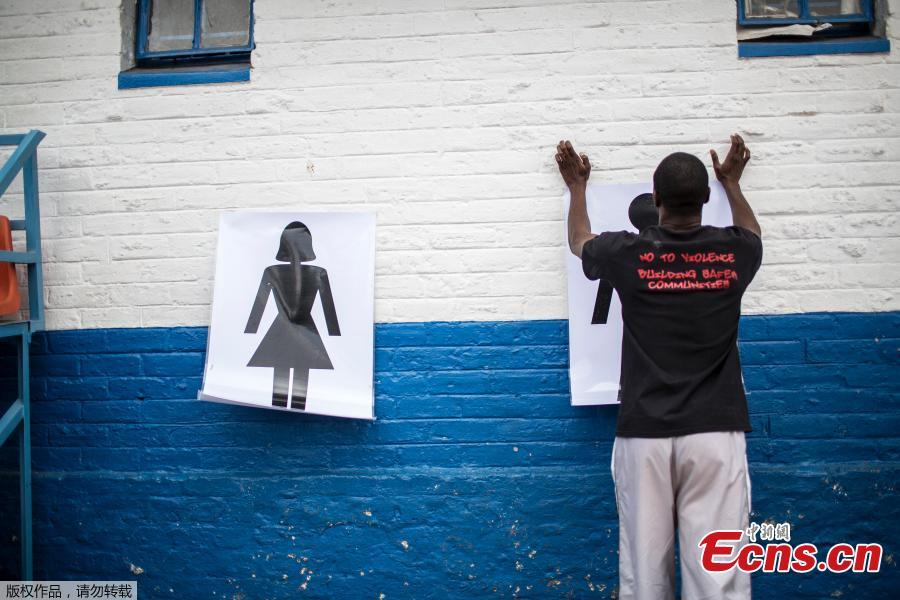 Instructor Den Manda, 23, puts up charts on a wall during a session with NGO Action Breaks Silence (ABS) called the \'Hero empathy programme for boys\', which challenges gender stereotyping and builds feelings of empathy and respect towards women and girls, at Mbuyisa Makhubu Primary School in the area of Orlando West, in the South African township of Soweto, on October 10, 2018. (Photo/Agencies)